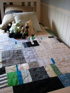 my type of quilt. when i get around to doing one...it would be like this. ok maybe with some red in it. and some random embroidered stuff.