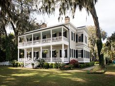 This Savannah cottage features two full-length porches that look out onto the Vernon River. #southernhomes #gardenandgun Photo Credit: Imke Lass.