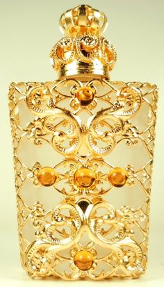 Filigree vintage perfume bottle. What seems to be the 4 beads? on the front of the bottle. OK 5 balls.