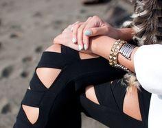 Elizabeth Rosaline tore this image to their profile. More than 22 StyleSaints retore this photo. Black cutout leggings, metallic bracelets, blue nail polish, street style.