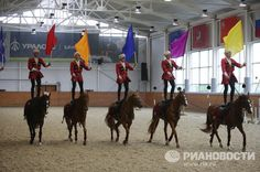 The program includes elements of the traditional trick-riding technique and involves mounted and dismounted riders in Cossack uniforms practicing their traditional weapons drill in formation.