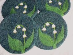Wool Felted Coasters with a Needle Felted Lily of the Valley flower.