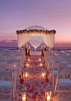 Sunset Beach Wedding. GORGEOUS! THIS is what I want as my wedding. Everything about it is perfect, following with the lighting of balloon lanterns being released...Oh my.