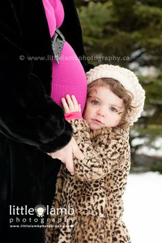 Winter maternity photography in the snow.  Photo by Little Lamb Photography.  Ottawa & Gatineau maternity photographers.