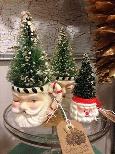 An awesome way to display old Santa mugs!