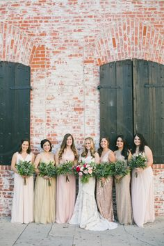Mix and match bridesmaid dresses + foliage-filled bouquets: Photography : One Love Photography | Photography : onelove photography Read More on SMP: http://www.stylemepretty.com/california-weddings/los-angeles/2016/07/18/youll-love-how-this-bride-surprised-her-groom-at-their-destination-wedding/