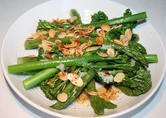INGREDIENTS:1 bunch of broccolini1 bunch of asparagus1/3 cup (25 g) slivered almonds1 – 2 garlic cloves, crushed1 tbsp lemon juice2 tbsp olive oilsea salt and pepper, to taste