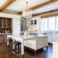 White and Brown Kitchen with Wood Ceiling Beams