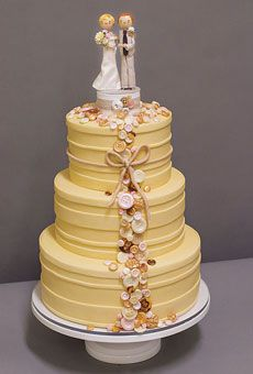 Brides: Outstanding Wedding Cake Designs : Wedding Cakes Gallery, Brides.com (flowers, instead of buttons, climbing cake to toppers?)