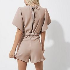 Petite collection Woven fabric Frill trims Elasticated rear waist with tie front Short flared sleeve Round neck Open back detail Button loop back fastening Our model wears a UK 8 and is 161.5cm/5'3'' tall