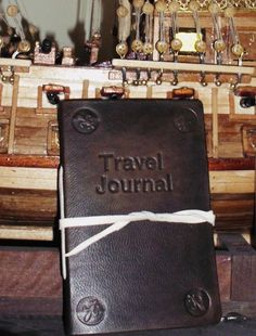 LIBERARTE artistic bookbinding and book restoration   Handmade leather travel journal engraved with the word travel journal, if you want can