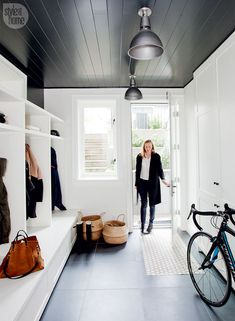 A once tiny starter house becomes a family's dream home With a cubby for each family member along one wall and meticulously laid-out closets on the other, the mud room is an ultra-organized treat for the active family. Mudroom Laundry Room, Laundry Room Design, Style At Home, Starter Home, Built Ins, Home Fashion, Home Staging, Living Room Designs, Mud Room Designs