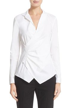Free shipping and returns on Lafayette 148 New York 'Iconic Collection - Odetta' Stretch Cotton Blouse at Nordstrom.com. A feminine update on the classic wrap shirt, this tailored blouse flatters with a sharp cutaway hem and waist-sculpting pleats radiating from the side. The stretch-poplin fabric blends superfine cotton yarns with a touch of Lycra® spandex for smooth, polished finish and comfortable feel.