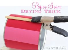 Use a Popsicle stick and a clamp to keep the paper lying flat while it dries.