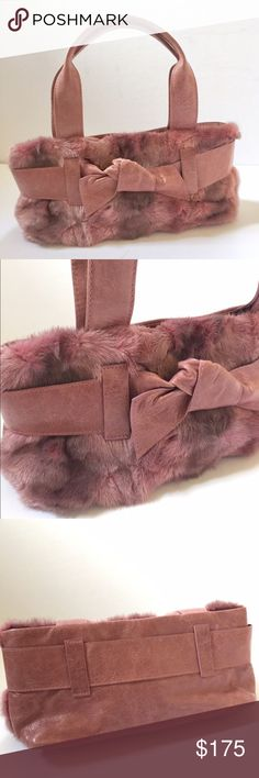 """Roberta Gandolfi Pink Fur Satchel Super cute and girly mini pink fur and leather satchel by Roberta Gandolfi with double handles, magnetic top closure, interior with 3 separate compartments and 2 slip pockets. Made in Italy. Worn a few times. * Has a few small scratches in leather part of bag that blend in and are unphotographable. Comes with dust bag. Width 12"""", Height 5"""", Depth 4"""", Handle Drop 5.5"""". Roberta Gandolfi Bags Satchels"""