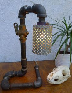 Recyclica Metallic Disco Lamp... made from refurbished pipes.