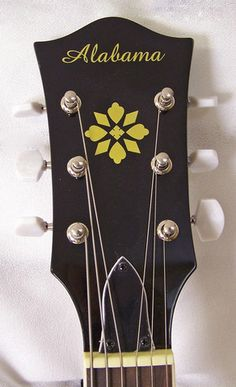 """Also known as the """"banjitar"""" the Alabama 6 String Banjo gives you all the sound and glory of a banjo with a 6 string guitar neck.  Play all the same shapes, licks, and tricks you know on guitar with that bright, punchy banjo sound."""