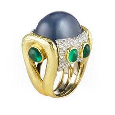 David Webb 'Machine Age Ring II', Cabochon Star Sapphire, Cabochon Emeralds, & Diamonds (=)