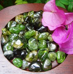 "Peridot furthers the understanding of changes which are occurring in ones life. Can be used to stimulate the heart bringing openness and acceptance in matters of love and relationships. Provides a shield of protection. Can be used to heal a ""bruised"" ego by lessening anger or jealousy, inspiring happiness within the self and delight in the nature of ones life.   www.sacredstonegallery.com Green Gemstones, Crystals And Gemstones, Stones And Crystals, Crystals Minerals, Rocks And Minerals, Peridots, Crystal Meanings, Rocks And Gems, Holistic Healing"
