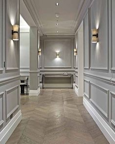 This hallway exudes calmness@with its contemporary colour palette and traditional highlights. . . . . . . @kibre.interiors 100% class  _______________________________________________________  #chevronparquet #portaromana #wallpanelling #contemporarydesign #interiordesign #london #kibreinteriors