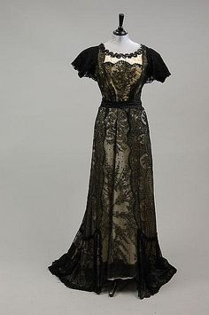 ca 1890-1900, comprising yellow silk ball gown with black bead & lace overlay