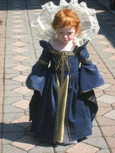 Tudor darling. A minature Queen Elizabeth I, King Henry VIII's daughter by Anne Boelyn -- both redheads!