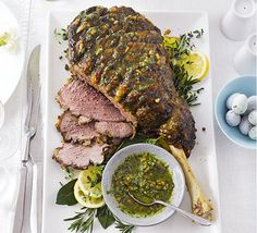 Roast leg of lamb with basil & mint pesto. Score the skin of your lamb and marinate with a herby, garlicky pesto for an extra special Sunday roast