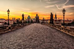 Charles Bridge at sunrise. Charles bridge is a famous historic bridge which spans the Vltava river in Prague in the Czech Republic. [via Trip2Blog.com]  submitted by: Ryan, thanks!