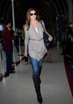 Travel style: Cindy Crawford is the very definition of effortless style for me. Her style is unpretentious and simple - she's not trying too hard; and that's hot. On long flights you want to look together enough to represent your business, as you most likely will engage in longer conversation that will require you to exchange business cards, yet you want to be comfortable still. I love leather boots over jeans along with a belted oversize sweater (comfy enough to nap in) and aviators.