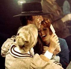 Summer 1977: Agnetha and Frida with actor Robert Hughes working on a dream scene in a saloon in The Movie.