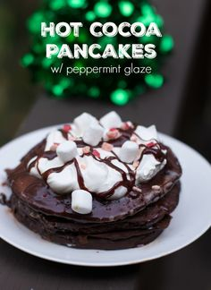 Create these short cut hot cocoa pancakes with a peppermint glaze recipe for your holiday breakfast.  Nothing better than a little chocolate and peppermint syrup for Christmas  #12DaysofPancakes #ad