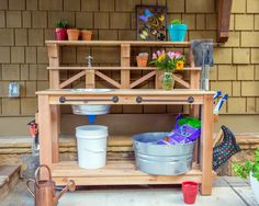 Could you use work space for projects? how to build a custom work table for your gardening and outdoor chores. We outfitted this bench with a dry sink, tool storage and plenty of shelving. Potting Bench With Sink, Outdoor Potting Bench, Potting Bench Plans, Potting Tables, Rustic Potting Benches, Outdoor Benches, Farmhouse Bench, Potting Soil, Diy Storage Bench