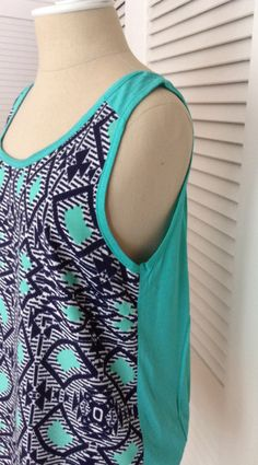 i like the mixed fabrics and the tribal print.  also more bright colors and sleeveless for Atlanta summers!