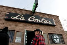 """Zane Swiley of Savannah, GA enters La Conte's Clone Bar & Dispensary during a marijuana tour hosted by My 420 Tours in Denver, CO on December 06, 2014. Swiley said this was his second tour with the group, """"it's high quality folks, everything they do is first class."""" During the day tourists visited La Conte's grow facility, La Conte's Clone Bar & Dispensary, Native Roots dispensary  and Illuzions Glass Gallery.  (Photo By Craig F. Walker / The Denver Post)"""