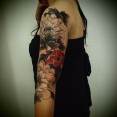 black and red floral tattoo. Shading and I flower colored