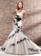 Corinne - by Maggie Sottero    this is simply stunning. however, I'm not liking the black =/