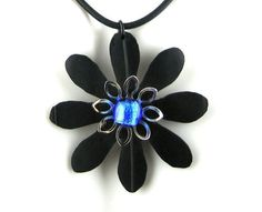 Recycled Bike Inner Tube Daisy Flower Necklace by PartsAndScraps, $15.95