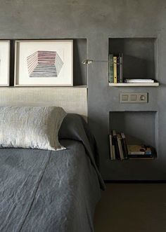 Recessed Shelving in a Concrete Bedroom   Remodelista (referencia de cabeceira e cores)