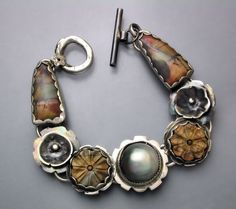 Sterling silver bracelet by Temi Kucinski Grey Mabe Pearl, Picasso Jasper carved flowers and Picasso Jasper stones at the ends