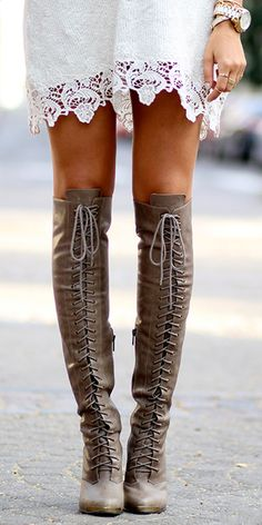 Lace-up thigh-high boots.