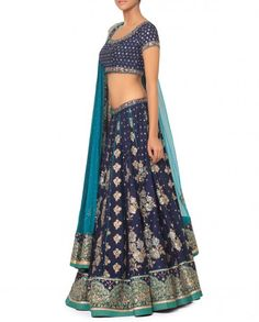 Royal blue Lehenga featuring pleats with light blue piping. Ari embroidery all over featuring multicolor floral motifs. Golden and light blue border panel on hemline. Blue short sleeves embroidered blouse with plunging back included. Wash Care: Dry clean onlyMatching Dupatta included