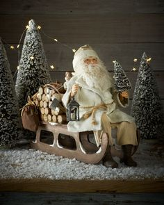 Santa on Log Sled by Bethany Lowe at Neiman Marcus.