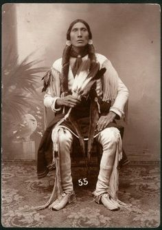 A beautiful Comanche man with a gorgeous feather fan http://traditionalnativehealing.com