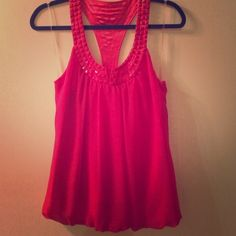 Hot pink ladies blouse tank Hot pink ladies tank with decorative beads V back with a U shaped design in the front with a little slit for peekaboo cleavage. I think the only time I wore it was when I tried it on in the dressing room Charlotte Russe Tops Tank Tops