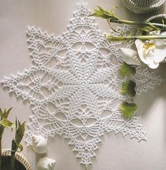 Lots of free chart patterns for table mats and doilies at this link ... including this one. :)