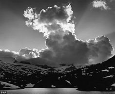 The genuine article: Adams' 1934 photograph 'Thundercloud, Ellery Lake, High Sierra, California'. Experts say Adams' negatives are almost worthless since most of his creativity was down to how he produced photos in the darkroom