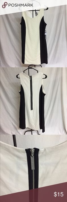 """Kensie fitted black & white dress with zipper back Cute black and white new with tags on Kensie dress. Figure flattering with black sides. """"Lace"""" in front and zipper closure in back. Size large. Kensie Dresses Mini"""