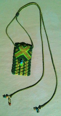 Micro macrame medicine pouch. Takes 4-5 hours to make. AUD38. Dark green, light green & flouro green waxed polyester threads with turquoise button & prehnite, tiger eye, serpentine, blue apatite & turquoise on the ends of straps.