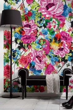 Big bold flower wallpaper with the contrasting black furniture.
