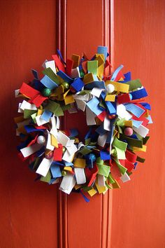 "Felt wreath. No sew. 1""x7"" strips. 12"" wire wreath form. July 4th wreath idea."